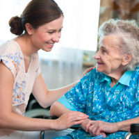Elderly hospice patient with caregiver