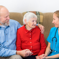 Hospice nurse and elderly couple