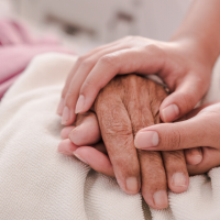 holding elderly hands